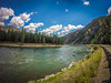 flathead reservation landscapes in montana (DigiDreamGrafix.com) Tags: landscape mountains wideangle missionvalley mountainrange bluesky northamerica sunnyday bigskycountry rockymountains vibrantcolors landscapephotography wispyclouds snowcappedmountains saturatedcolors westernus travelphotography westernunitedstates ruralamerica nationalbisonrange arrowleafbalsamroot velvialook lushgreenvalley green colors yellow colorful vibrant sky outdoors rural majestic sunflowers sunny flowers clouds springtime wildflowers