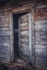 Unlatched (CTfotomagik) Tags: nikon wide angle colorado weld county door doorway weathered decay rural farm country garage crusty old abandoned neglected