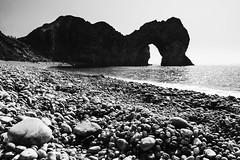 Dudle Door Noir (Christian Hacker) Tags: durdledoor limestonearch jurrasiccoast dorset england seascape geology pebbles coastal coast british canon tamron blackandwhite mono landscape rock arch popular