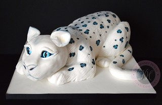 Crouching Snow Leopard