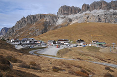 Pordoi Pass (Vee living life to the full) Tags: nikond300 river roads mountains view landscape bluesky town italy dolomites lake water sunshine reflections outrips pordoipass resort tourism tourist skiing holiday urlaub ferien pleasure leisure sport hobbies walking blue sky clouds touring