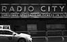 3,437M (Panda1339) Tags: thegreat50mmproject 50mm nyc newyorkcity umbrella streetphotography man usa radiocity cab monochrome