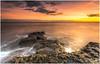 Cinder Toffee Sunrise (Steven Peachey) Tags: sunrise sun sea sky clouds morning beach rocks cliffs light exposure canon stevenpeachey lightroom northeastcoast northeastengland whitburn southtyneside ef1740mmf4l 5dmarkiv canon5dmarkiv graduatedndfilter leefilters lee09gnd hitech09gnd formatthitech uk england