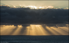 Shower me with light (Rob Millenaar) Tags: southafrica campsbay scenery landscape sky clouds light sunset evening
