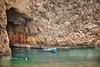 (787/17) Saliendo de la gruta (Pablo Arias) Tags: pabloarias photoshop photomatix capturenxd bote barca acantilado agua mar mediterráneo roca cominotto comino malta