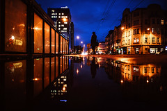 Puddles, puddles, everywhere. (ewitsoe) Tags: puddles reflection rain water canon 6dii sigma 20mmart art figure woman silhouette jezyce pozan poland polska autumn city cityscape urban reflect action walking night dusk evening wet cold