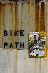 Bike Path (Katrina Wright) Tags: newyork nyc buildings city architecture rust texture line pattern bikepath sign graffiti