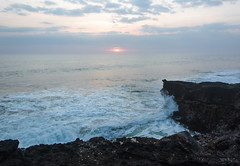 Wave hits a cliff, tanah lot, bali (anastasia r) Tags: bali indonesia background clear cliff coastline earth green ground hinduism island landscape lowtide lowwater nature ocean oceanfloor red relief rock rocks rocky rough sea seaweed shore stones sun sunlight sunset tanahlot temple terrain water waves kediri id