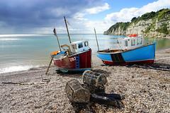 Fishing boats on Beer beach (1) (Jayembee69) Tags: beer devon uk unitedkingdom britain british gb england english seaside coast beach pebble cliff chalk fishing boat coastline lobsterpot fishingboat storm beached sun cloud