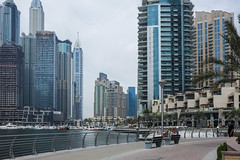 Dubai - downtown (Marian Pollock) Tags: dubai uae urban people reflections shops water architecture boats skyscrapers street