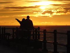 Sunset New Brighton (natlou_2506) Tags: newbrighton sunsetting sunset people couple sun sea ocean water orange clouds wallasey wirral