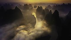 Dawn in another world (Massetti Fabrizio) Tags: sunrise sun sunlight landscape landscapes light xiangtangshan xianggongshan cina china guilin guangxi guanxi gold rural red fog clouds