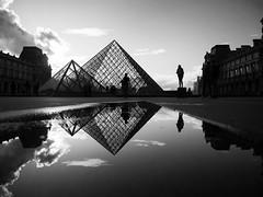 Paris Reflection (torobala) Tags: street streetphotography blackandwhite monochrome silhouette people person one lonely paris france louvre tourist pyramid pyramids sunset clouds reflection parisstreet myparis
