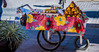 2017 - Mexico - Tequila - Sweet Treats (Ted's photos - For Me & You) Tags: 2017 cropped mexico nikon nikond750 nikonfx tedmcgrath tedsphotos tedsphotosmexico tequila vignetting wheels onebottle cart foodcart streetscene street shadow shadows tequilajalisco tequilapuebomágico tequilatour santiagodetequila magictownsofmexico pueblomágico pueblosmagicos jalisco sweets food desserts red redrule colorful colourful pushcart 3wheeler 3wheels spokes