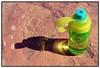 refreshing (Leonard J Matthews) Tags: water bottle rock light glow refresh hard soft mythoto green australia refreshment refreshing quench thirst contrast texture brown blue sparkle