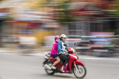 20171103_1045 (lgflickr1) Tags: vietnam hoian street movement colorful d750 70200 nikon scooter motorcycle twowomen passenger city streetphotography southeastasia asia red transportation streaks