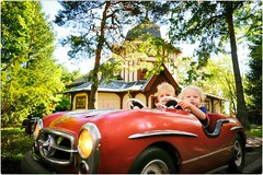 Easy Drivers (Steve Lundqvist) Tags: sweden stockholm street portrait photography boy red persone veicolo auto mercedes toy toddler skansen stoccolma park amusement tourism car driver