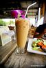 Nice cold Thai milk tea. (snakephoto) Tags: snakephoto thailand bangkok food ice tea sigma 1928 dn art lens sonya7