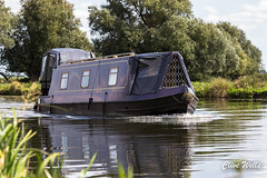 Narrow boat (wells117) Tags: boat ely longboat narrowboat ouse ripples river riverouse trees wake water