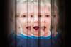 Jeux d'enfant et reflets (tad888) Tags: famillebouchard léonard verybest fête anniversaire birthday reflets reflects miroir mirror verticales bandes child kid expressive expressif bouche ouverte mouth