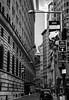 Wall Street, New York (Katrina Wright) Tags: dsc5765 wallstreet financialdistrict newyork nyc buildings architecture street narrow monochrome bw nb city