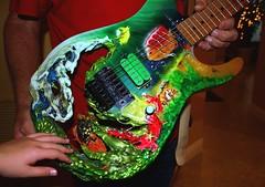 Mark's Ocean-Wave Guitar (PelicanPete) Tags: oldguysstillrock thanksgiving dinner turkey 15fordinner sitdown ourhouse southflorida usa coralspringsflorida unitedstates laura peter 4parents group 2nieces nephew aunt 3sisters cousin fun 2boyfriends people brotherinlaw grouping familyroom tripod fillflash smiles mom dad goddaughter food letstalkturkey music guitar rockon promusician thanksmark markmadehisownguitar guitarhasanoceantheme custom mrrocknroll oceanwaveguitar light wave turtle fish reef