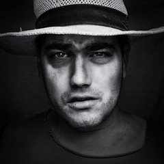 Bruised (cosmoguy1) Tags: bruised cowboy portrait lighting softbox diy continuous light hat blackwhite black white contrast clarity texture detail shadow reflectors eyes nikon d5300 kit lens wide aperture studio 1855 oben tripod vintage