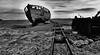 Run Aground (tcees) Tags: dungenessbeach romneymarsh dungeness kent bw mono monochrome blackandwhite nikon d5200 1855mm sky sand clouds boat railwaylines rails railway sleepers net fishingnet rope landscape chain
