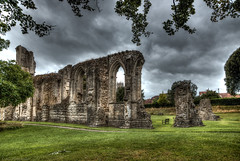 Walls fall, but grass still grows (Anthony P26) Tags: architecture category england external glastonbury glastonburyabbey hdr places somerset travel ruin decay abbey monastery placeofworship wall stonewalls stone building structure church clouds sky greyclouds cloudy grass lawn trees outdoor travelphotography architecturephotography gothicarchitecture arches canon1585mm canon70d canon