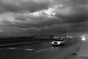 This Thing of Darkness... (Novowyr (back from travelling)) Tags: kuba cuba havana havanna elmalecón street city car storm tempest dark clouds sea waves breakers headlights 80 vintagecar road sturm wellen