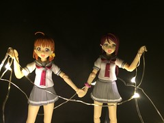 Chika and Riko Untangle the Christmas Lights (Sasha's Lab) Tags: riko sakurauchi 桜内 梨子 chika takami 高海 千歌 aqours high school idols uniform teen girls christmas light figma action figure gsc toy holding hands explored