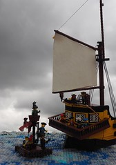 The End of the White Doubloon (Robert4168/Garmadon) Tags: lego ship brethrenofthebrickseas eslandola mardier bobs stern raft sail water ripples waves minifigure blue yellow brown captainwhiffo captain story