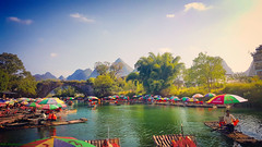 River viEw-1 (rashmou) Tags: yangshou beauty lake landscape village view river boat boatman col color image mountains mountain sky blue clo cloud green water umbrella travel bridge rural nature afternoon sundown