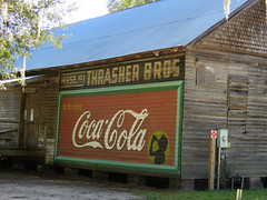 Thrasher Bros. (jimsawthat) Tags: smalltown micanopy florida coke cocacola ghostsign repainted vintagesign spanishmoss agriculture architecture