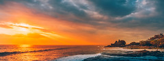 Tanah Lot Sunset (Iftakhar Hasan) Tags: indonesia bali tabanan tanahlot tanahlottemple puratanahlot rockformation beach cloud lightrays sunset sony sonyepz1650mmf3556oss sonyα6300