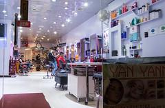Chinatown Barbershop (UrbanphotoZ) Tags: chinatown barbershop barber customer chair cutting mirrors reflection samples headshots yanyann yelp clock door fan ceilinglights magazines glassdoor downtown manhattan newyorkcity newyork nyc ny