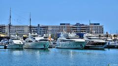 Four beauties (Szymon Simon Karkowski) Tags: outdoor four 4 beauti beauties yacht port marina hotel porta maris alicante alacant espana nikon d5100 boat water sky building