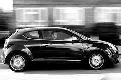 "Panning. ""Keep your eyes on the road......."" (markwilkins64) Tags: frozen stare glance pan vehicle technique panned driver momentum shadow light driving eyes monochrome mono blackandwhite travel car speed uk london panning blur windows wheels tyres male man road street candid"