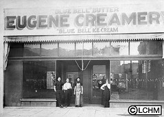 GN1916 (Lane County History Museum) Tags: lanecountyhistoricalmuseum lanecountyhistorymuseum vintage digitalcollection historicalphoto eugeneoregon workers creamery smallbusiness dairy storefront downtownbusiness
