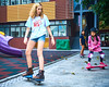 Skyline Skaters 29 (C & R Driver-Burgess) Tags: middleschool juniorhigh kids children boys girls young teen preteen ripstick inline skates skateboard pink blue shorts tights jacket tshirt concrete yard playground trees playing practice people