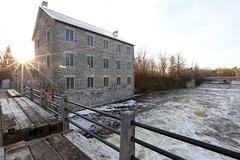 Sundowning on the old mill.. (deanspic) Tags: watsonsmill historic gristmill manotick ontario sun sunburst 6d rideauriver