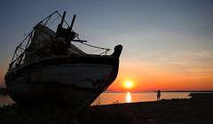 Leaving behind... life wrecks... (Michael Kalognomos) Tags: woman girl greece halkidiki chalkidiki ef24105mmf4l canoneos5dmarkiii goldenhour wreck fishingboat life hope lookforward summer landscape