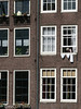 Laundry Day (lorinleecary) Tags: amsterdam patterns thenetherlands windows building laundry oldwoman