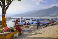 Fruit seller (Explore ) (Dick Verton ( more than 13.000.000 visitors )) Tags: pokhara pewalake vendor woman boats hills asia nepal traveling people sit sitting seated