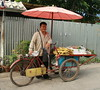 street vendor with his cart (the foreign photographer - ฝรั่งถ่) Tags: man street vendor corn peanuts cart umbrella bangkhen bangkok thailand canon