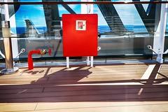 W (roberke) Tags: red rood detail sea ship schip zonnig zonlicht schaduw shadow shapes vormen dek vloer floor water clouds wolken blue blauw reflectie reflection lijnen