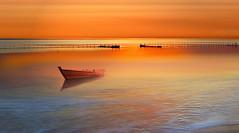Nessuno (Zz manipulation) Tags: art ambrosioni zzmanipulation boat barca rosso arancio tramonto sea water molo rada porticciolo