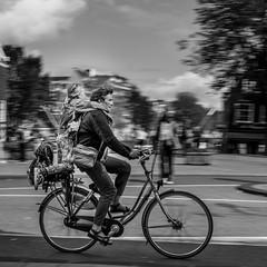 dutch school run (Derek Robison) Tags: amsterdam places people street bike bicycle blackandwhite bandw