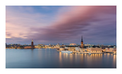 Stockholm skyline (Andreas Larzon Photography) Tags: andreaslarzon autumn bluehour bluesky boats building buildings calmwater church city cityhall cityscape ctylights ctyskyline fujinonxf1855mmf2840 fujixt1 harbour landscape midclouds mälaren riddarholmen ruleofthirds serene ship shoreline sky smoothwater stockholm streetlights sunset sweden water house