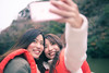 Happy sisters taking selfie picture on tour boat (Apricot Cafe) Tags: img72374 asia asianandindianethnicities healthylifestyle japan japaneseethnicity tamronsp35mmf18divcusdmodelf012 autumn autumnleafcolor candid carefree casualclothing charming cheerful chibaprefecture colorimage crossprocessed enjoyment forest happiness lake leisureactivity lifejacket lifestyles lowangleview mountain onlyjapanese outdoors people photographing photography realpeople relaxation selfie sister smartphone smiling sustainablelifestyle togetherness toothysmile tourboat tourism tourist traveldestinations twopeople waistup weekendactivities women youngadult kimitsushi chibaken jp
